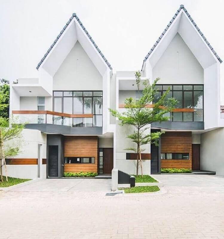 fachada de casas geminadas modernas com parede de vidro Foto Rumah Dijual