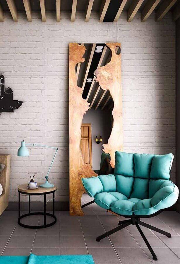 poltrona verde água para decorada de sala com parede de tijolinho Foto Pinterest