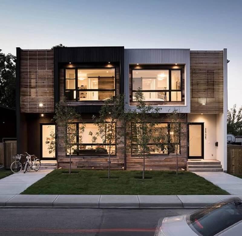 projetos de casas geminadas com revestimento de madeira e janelas amplas Foto Modaya Dair