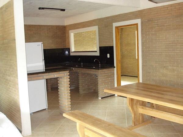 Casa com tijolo ecológico na área gourmet