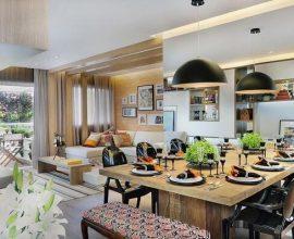 Harmonize formas e cores entre os ambientes de sala de estar e jantar integradas. Projeto de Quitete & Faria