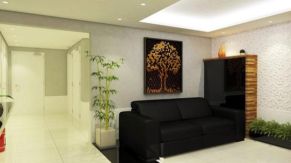 Sofá preto de 2 lugares compõem o projeto de decoração da sala