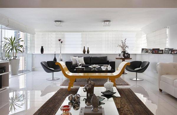 Transborde elegância ao mesclar sofá preto e branco na decoração