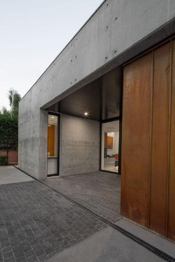 aço corten fachada moderna com cimento queimado Foto Pinosy