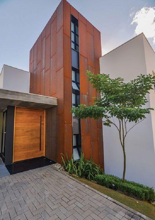 fachada moderna feita com cimento queimado e aço corten Foto Pinterest