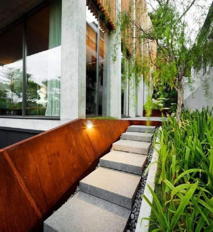 jardim decorado com chapa de aço corten Foto Homesthetics