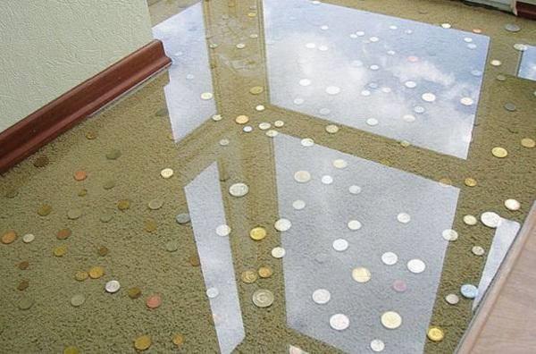 Piso 3D criativo feito com moedas