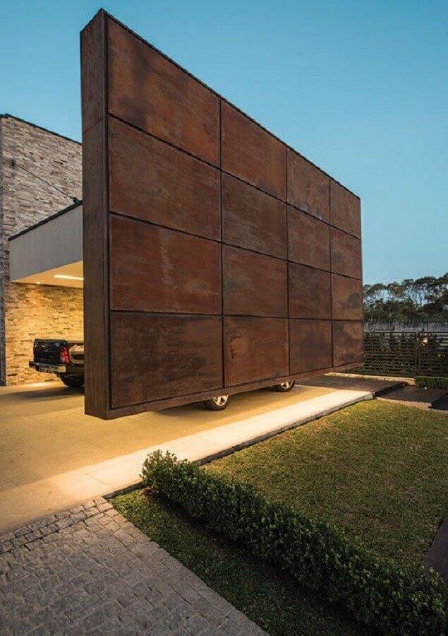 revestimento aço corten para garagem com parede suspensa  Foto Pinterest