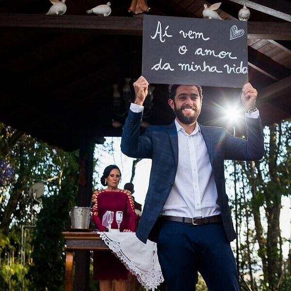 Wedding sign held by the groom himself at the time of yes
