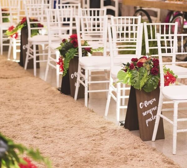 Wedding signs adorn the entrance area of the bride and groom