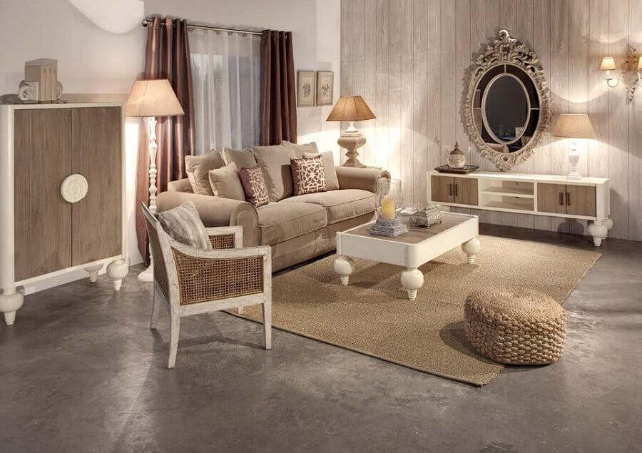 decoração clássica para sala em tons neutros com puff de pneu