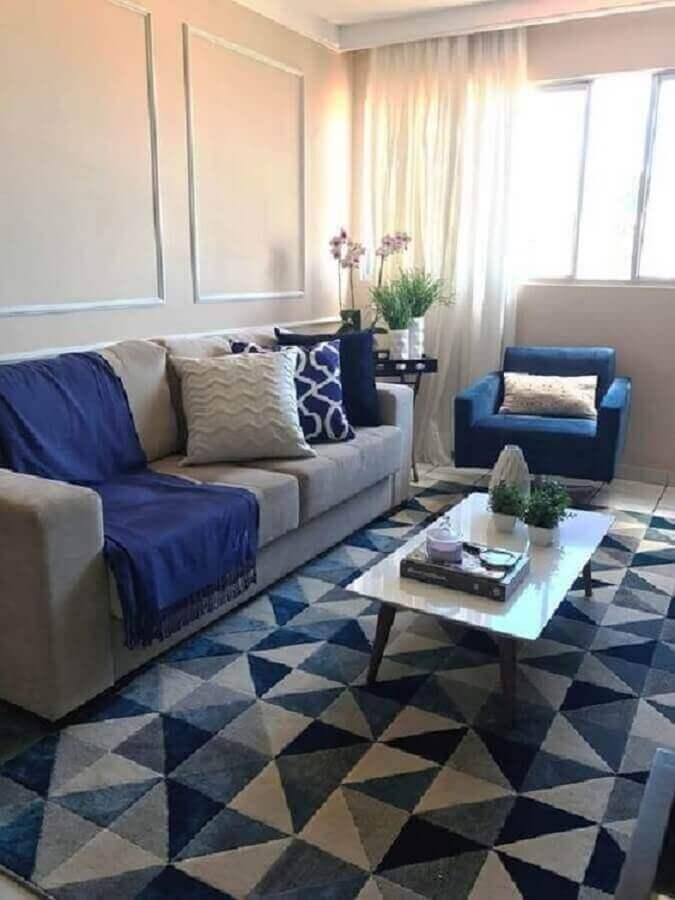 Decoração de sala de estar com tapete azul e cinza geométrico Foto Pinterest
