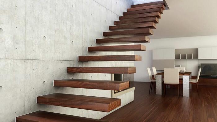 Escada flutuante de madeira fixada em parede de concreto