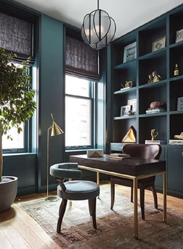 Escrivaninha preta com design minimalista e pernas douradas