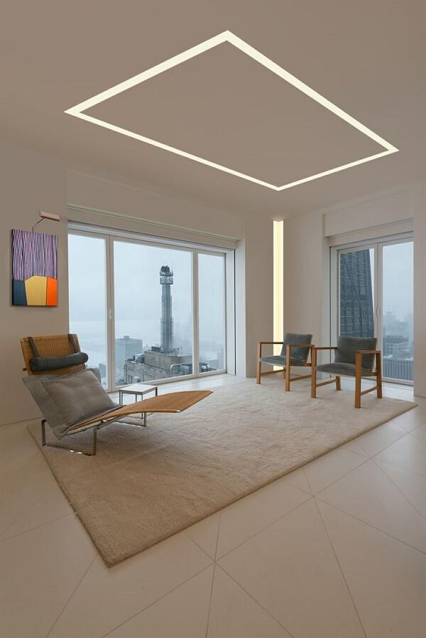 Sala de estar com teto de gesso e iluminação embutida