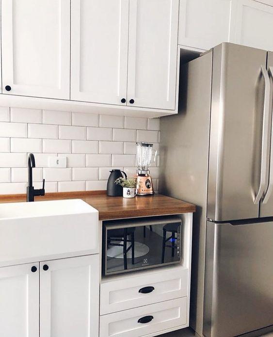 bancada de madeira - cozinha com bancada de madeira em todo o cômodo