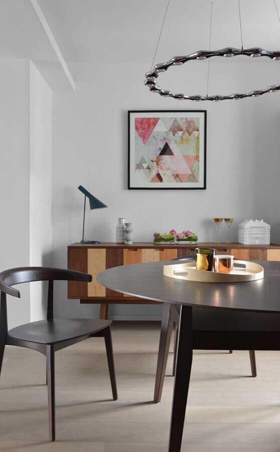 decoração clean para sala de jantar com buffet de madeira e quadro tumblr Foto Zozu