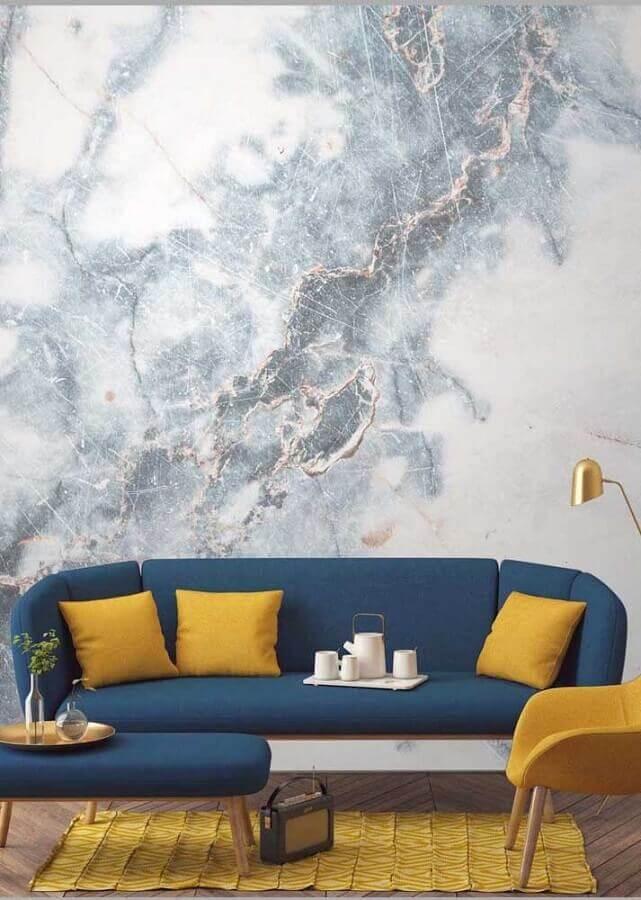decoração de sofá azul petróleo com almofadas amarelas Foto ArsCity