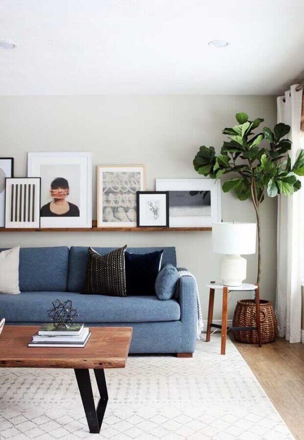 decoração em tons claro para sala com sofá azul Foto Zozu