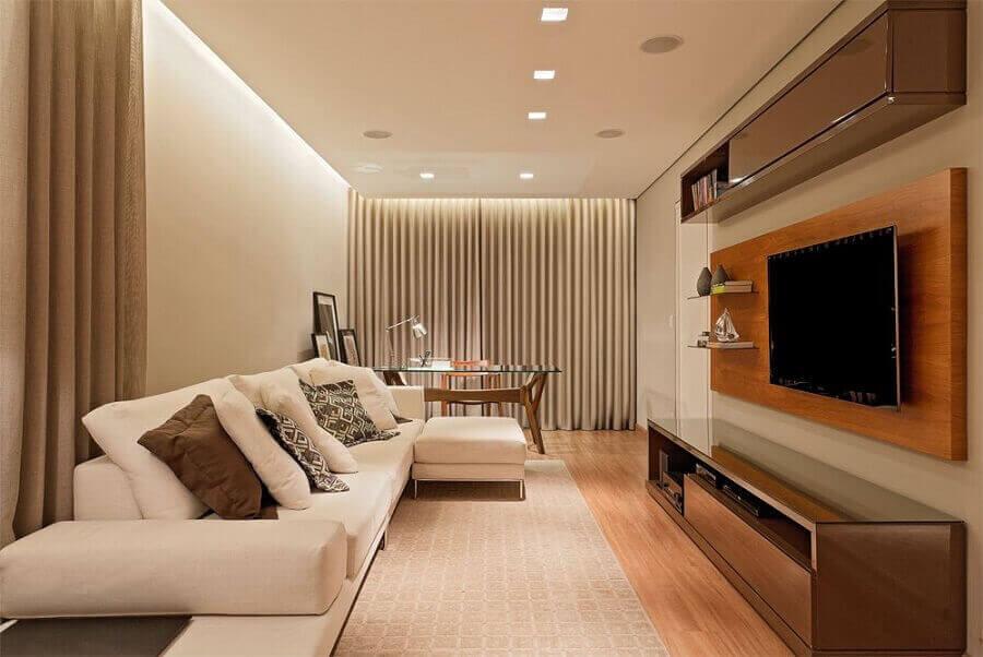 decoração em tons neutros com painel de madeira com rack Foto LEDS Arquitetura