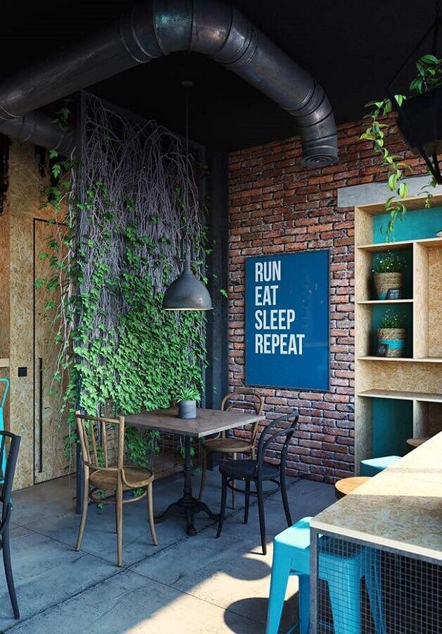 decoração estilo industrial para ambiente com parede de tijolinho e quadro azul petróleo Foto Pinterest