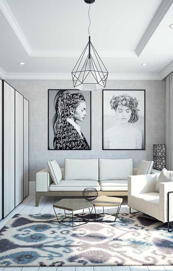 decoração moderna para sala cinza com mesa de centro diferente e quadros tumblr grandes Foto Behance