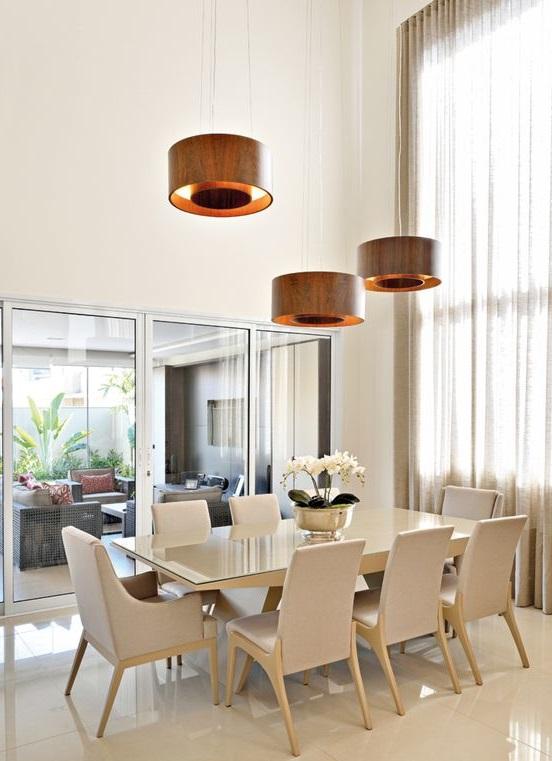 modelos de lustres - lustres de sala de jantar com cúpulas laranjas