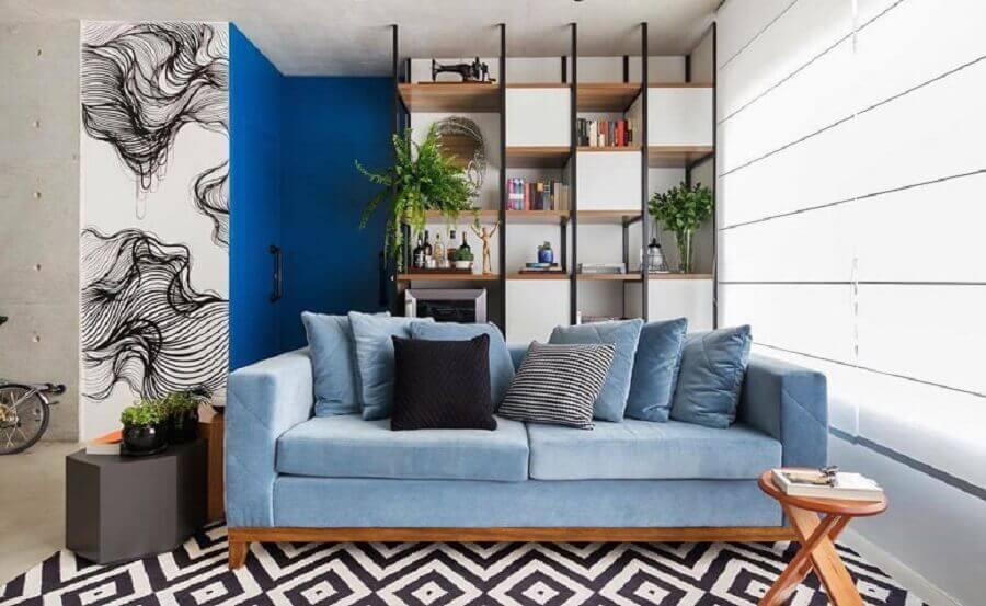 varanda decorada com sofá azul claro Foto SP Studio Arquitetura
