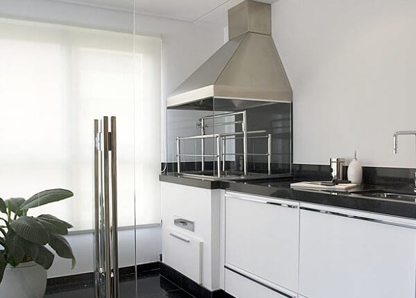 Área gourmet pequena com decoração clean