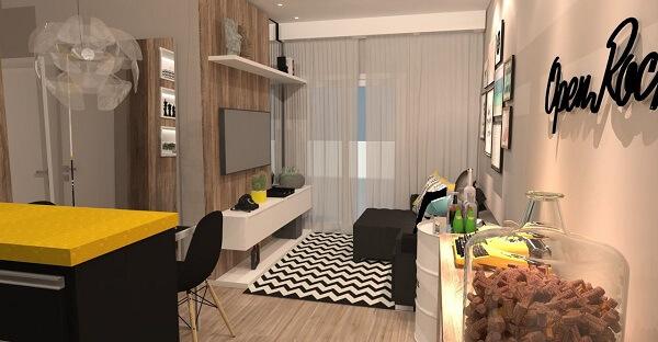 Sala de estar compacta com tapete preto e branco chevron