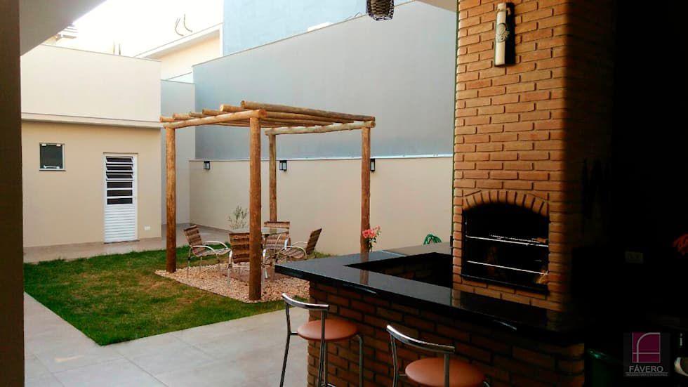 churrasqueira de tijolo - varanda com churrasqueira de tijolos e bancada de granito