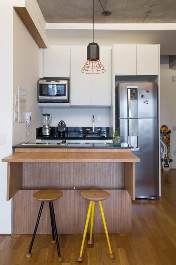 cozinha pequena decorada com pendente aramado cobre Foto ArchDaily