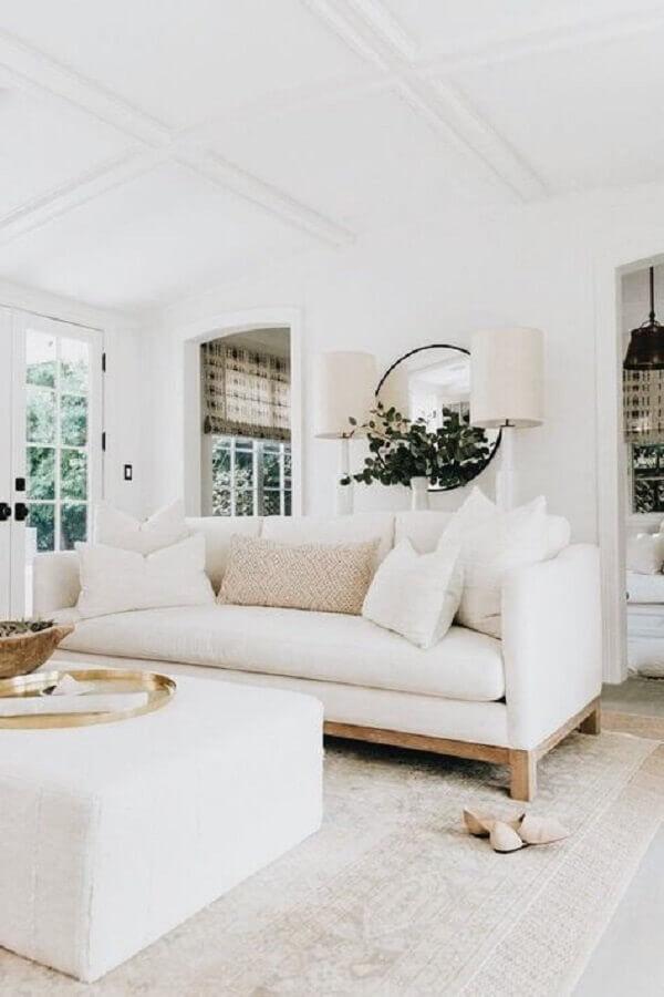 decoração clean para sala com sofá branco e espelho redondo Foto American Home