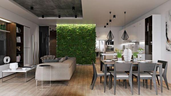 Sala de estar integrada com sala de jantar e pendentes aramados preto
