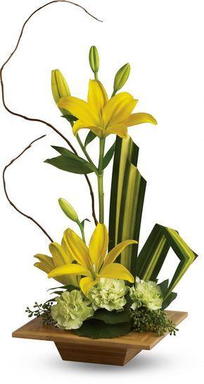 flores artificiais para decoração - flores amarelas em vaso de madeira