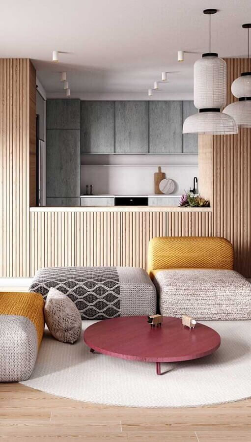 sala moderna decorada com mesa de centro cor marsala Foto Architizer