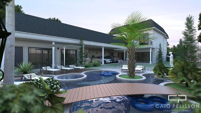 Casas com piscinas e ponte de madeira