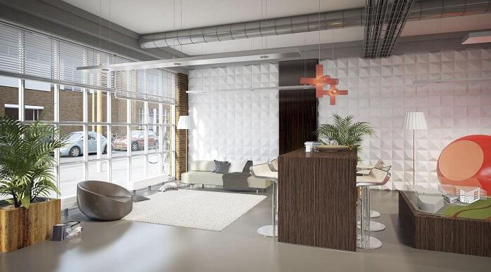 Projeto corporativo com parede revestida com placa de gesso 3D