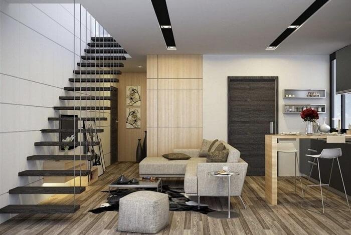Sala com escada preta flutuante