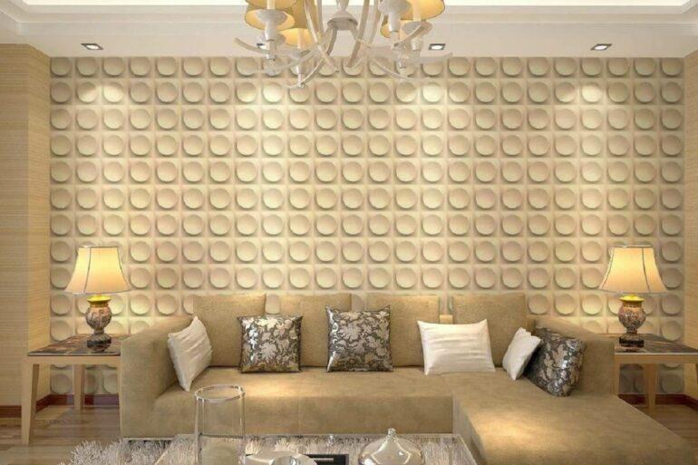 Sala de estar com parede revestida por placa de gesso 3D com desenho redondo. Fonte: Móveis Capão Raso
