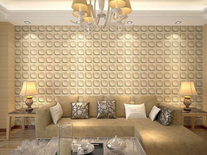 Sala de estar com parede revestida por placa de gesso 3D com desenho redondo