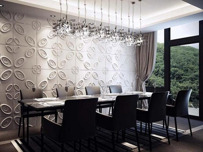 Sala de jantar com parede feita em placa de gesso 3D