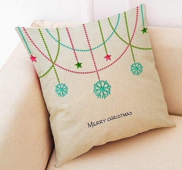 Decore a casa com almofadas de Natal feitas com tecido de juta