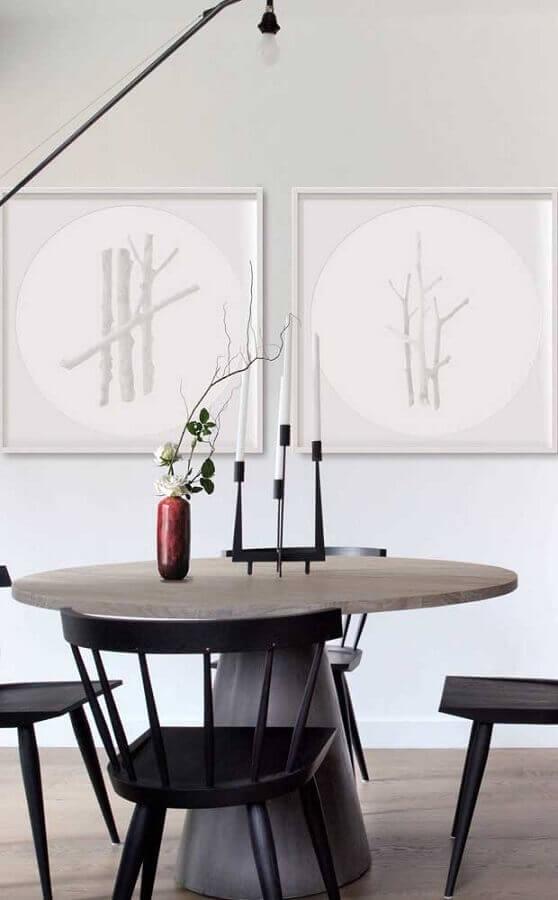 decoração sala de jantar com mesa de redonda e castiçal moderno Foto Behance
