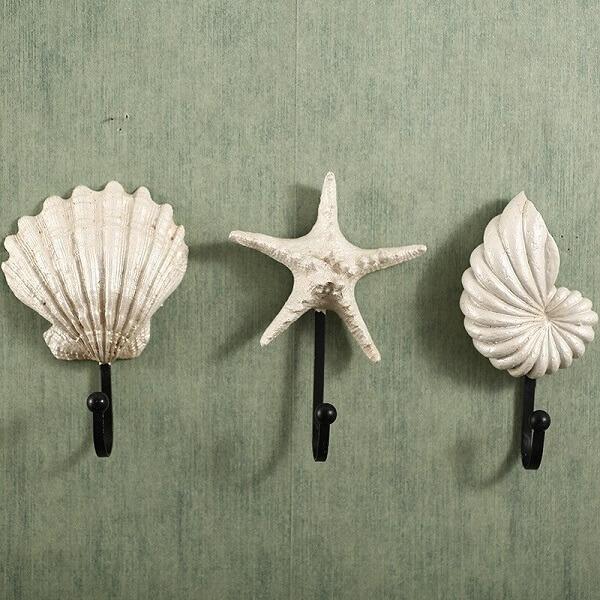 Gancho de parede em formato de conchas e estrela do mar