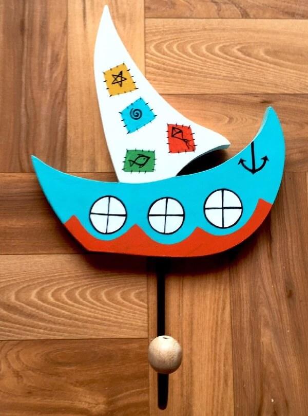 Gancho de parede em formato de barco