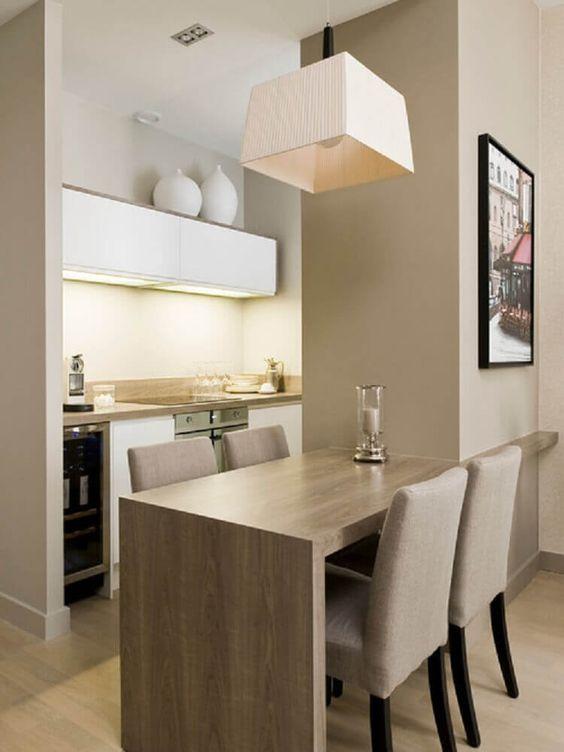 lustres simples - lustre simples sobre a mesa de jantar