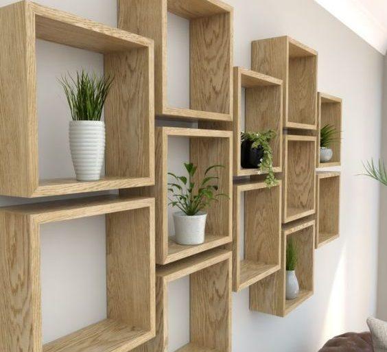 nichos de madeira com vasos de plantas - BespOak Interiors