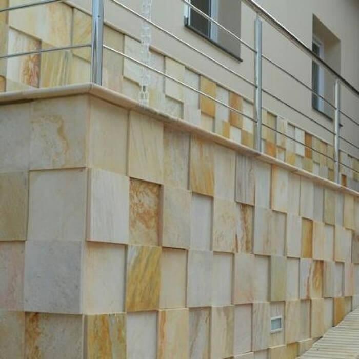 Fachada de casa feita com mosaico de pedra São Tomé