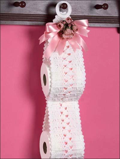 Porta papel higiênico com flores e laço de fita